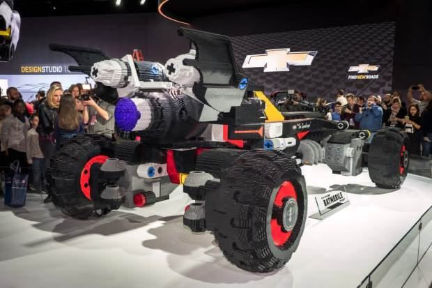 A life-size LEGO Batmobile is unveiled in the Chevrolet exhibit Saturday, January 14, 2017 on opening day of the North American International Auto Show in Detroit, Michigan. The 17-foot long vehicle was inspired by Batman's Speedwagon featured in The LEGO Batman Movie, which hits U.S. theaters on Feb. 10. (Photo by Steve Fecht for Chevrolet)