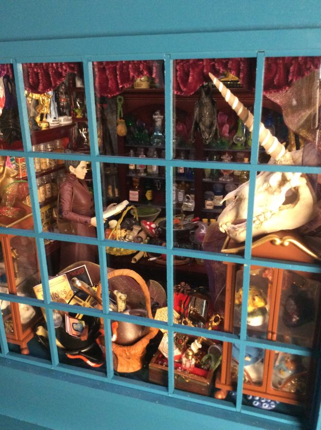 Dollhouse miniature magic shoppe with hand sculpted one 12 scale unicorn skull by Suzanne Forbes May 2021