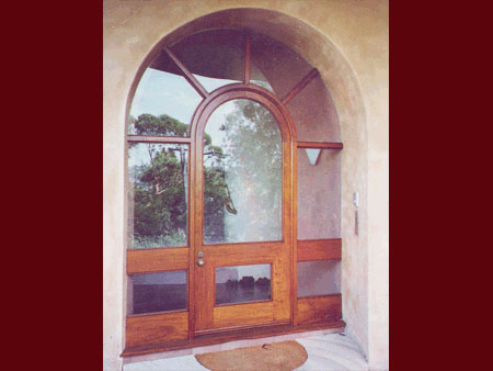 past joinery job arched front door