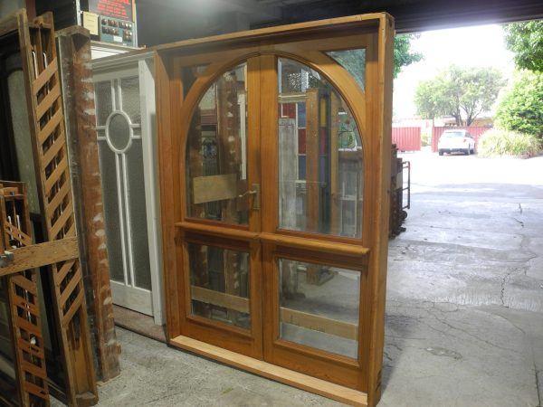 pair arched french doors in frame with beveled glass