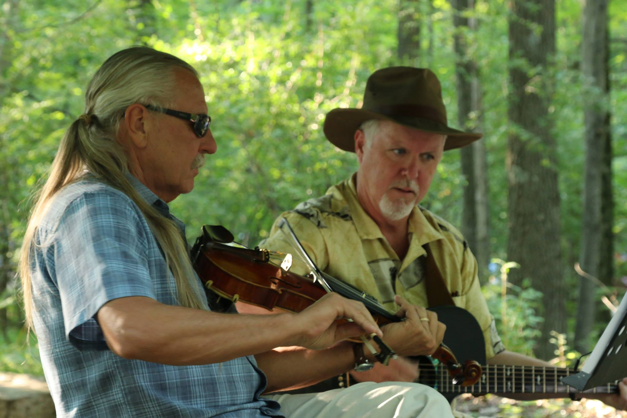 Daniel Bracken and Bruce Gartner perform bluegrass music