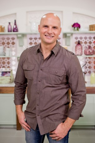 Host Chip Wade in the Carroll family's newly renovated kitchen as seen on HGTV and DIY Network's Elbow Room. (portrait)