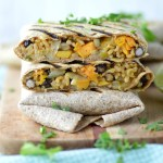 close-up of sweet potato black bean burritos stacked on each other