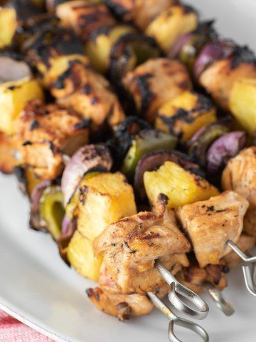 Hawaiian chicken kebabs on plate