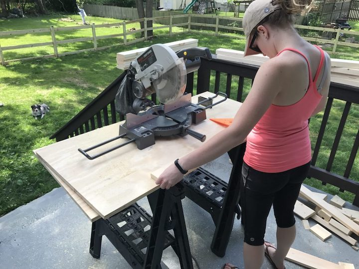 cutting wood for homemade Adirondack chairs