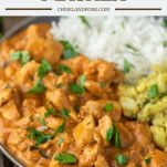 chicken tikka masala on grey plate with aloo gobi and white rice