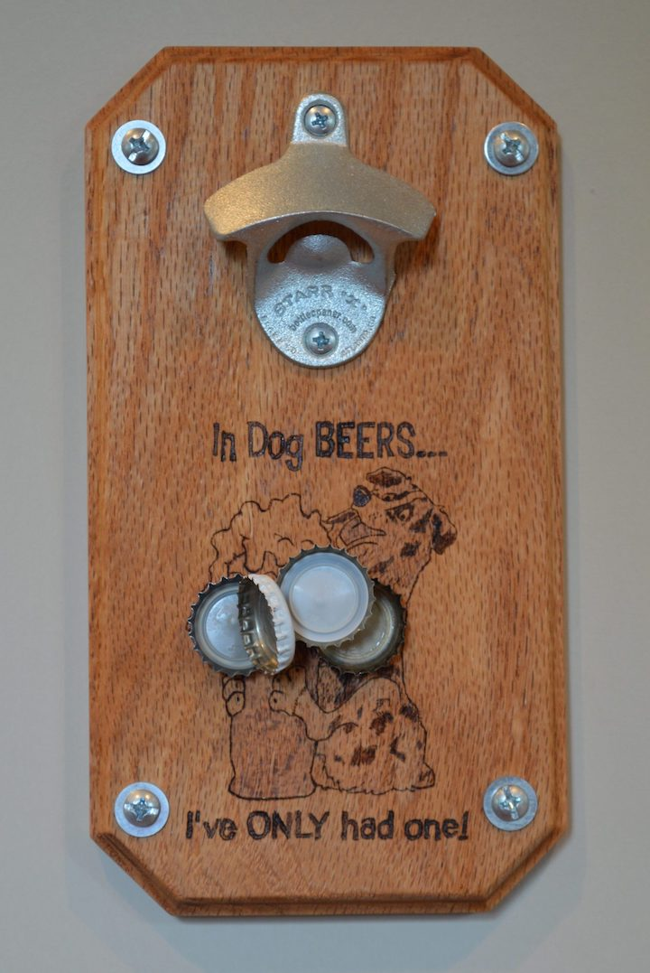 close-up of magnetic beer bottle opener with bottle caps