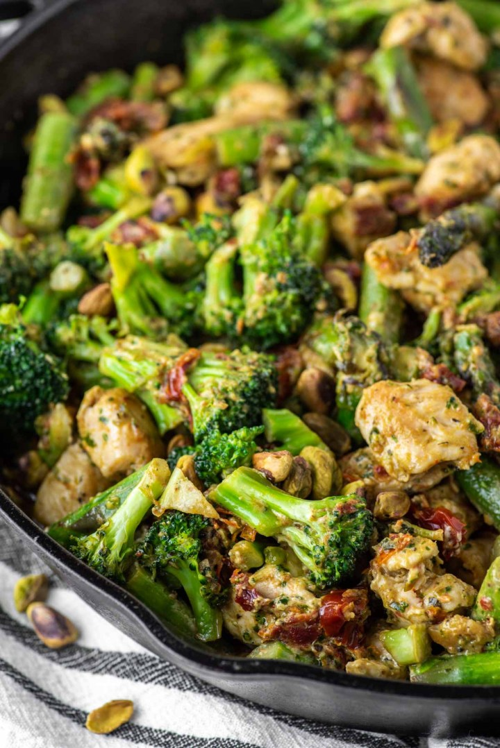 one pan pesto chicken and veggies in cast iron skillet