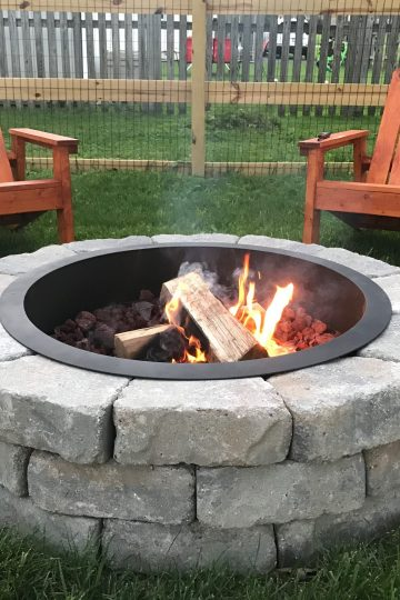 close-up of DIY fire pit with Adirondack chairs