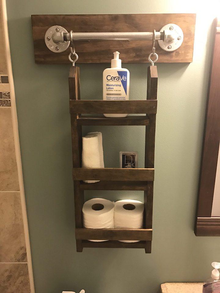 bathroom wall organizer hanging on wall