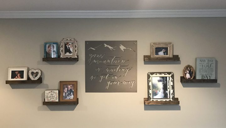 floating wood shelves on all with pictures