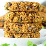 close-up of stacked sweet potato black bean burgers on white plate