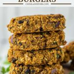 4 stacked sweet potato black bean burgers on wood board