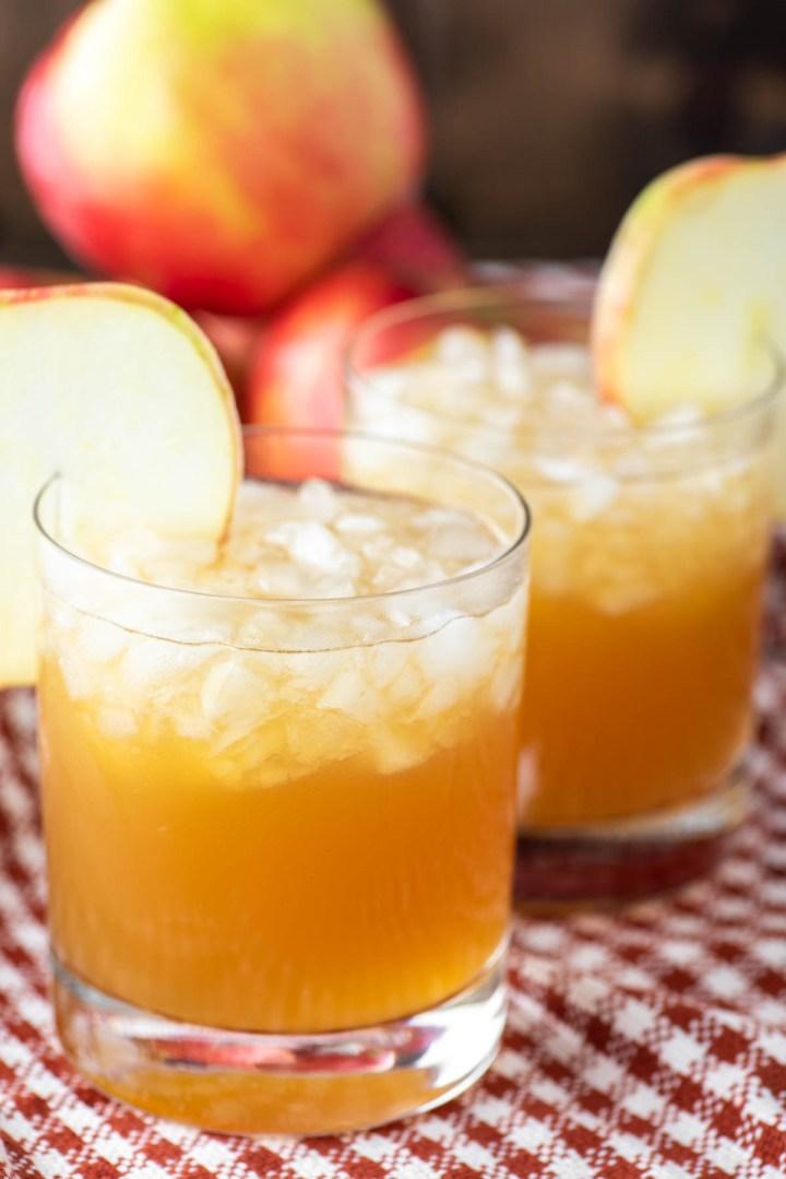two apple cider cocktails in glasses