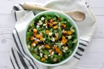overlay of fall harvest salad in green bowl