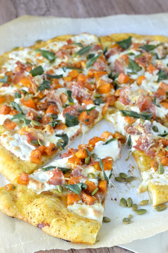 close-up of roasted butternut squash apple pizza on parchment paper