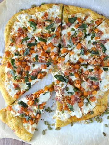 overlay of roasted butternut squash apple pizza on parchment paper