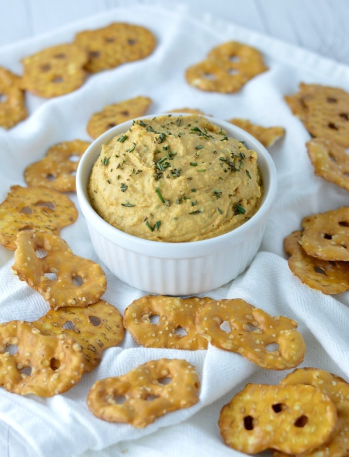 close-up of rosemary hummus in white ramekin