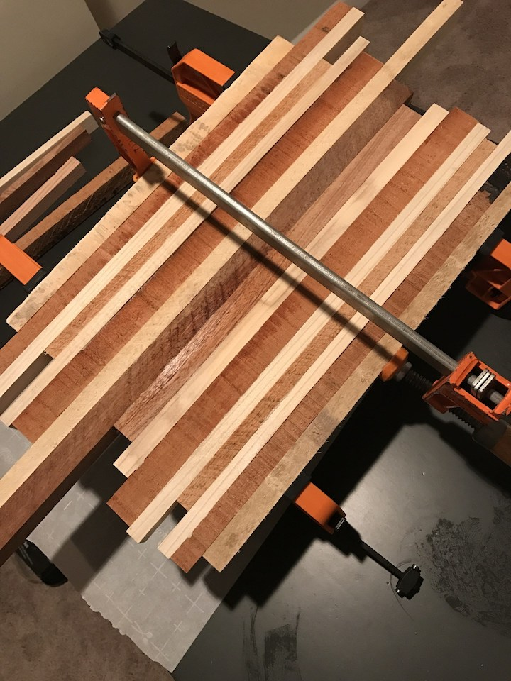 wood strips being glued and clamped together