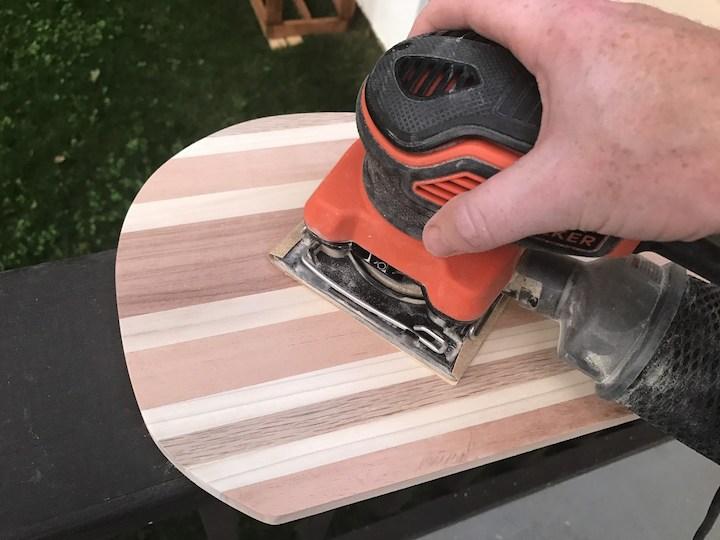 sanding whale cutting board