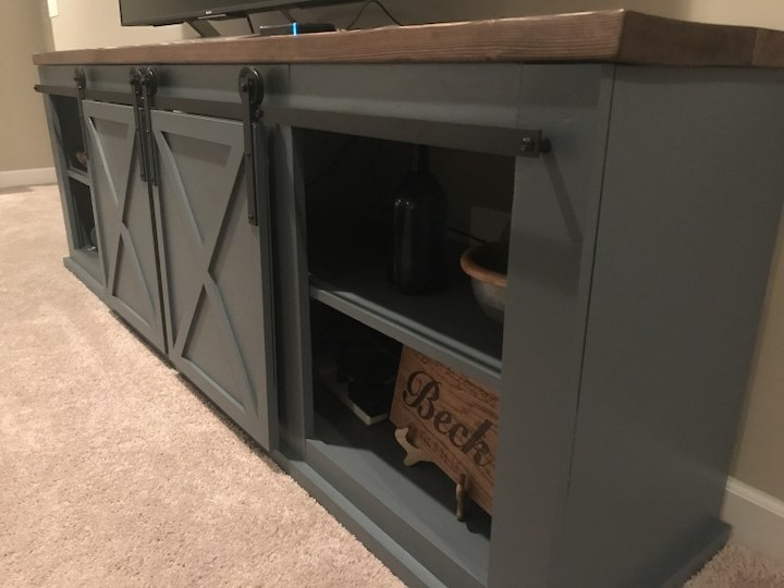 close-up side view of sliding door entertainment center