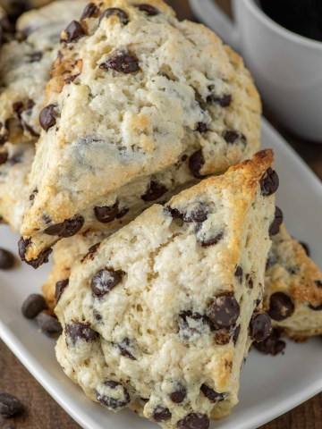 chocolate chip scones stacked on white plate