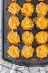 overhead shot of baked mac and cheese bites in mini muffin tin