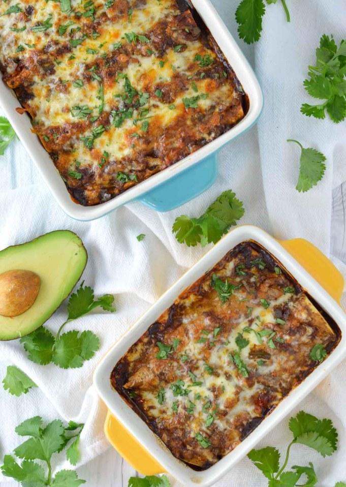 close-up of chicken mole enchiladas in baking dish