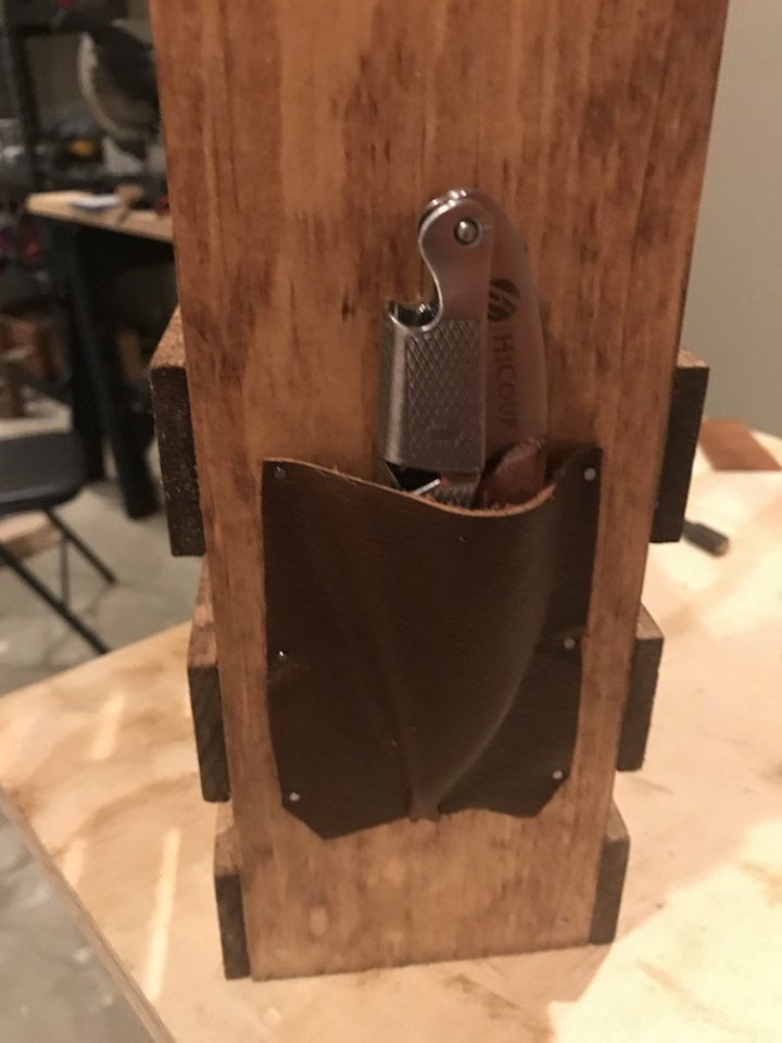 close-up of pouch that holds wine bottle opener on wine caddy