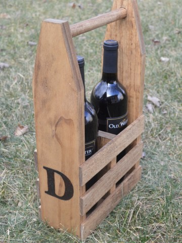 wine caddy with two bottles of wine on grass