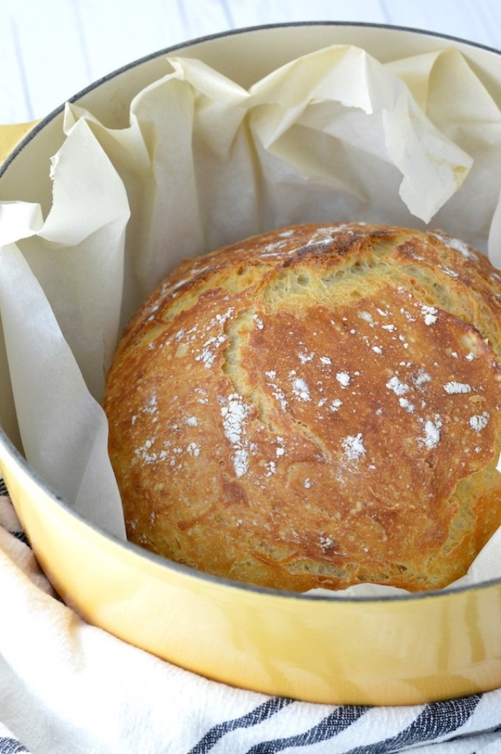 no-knead bread in yellow dutch oven