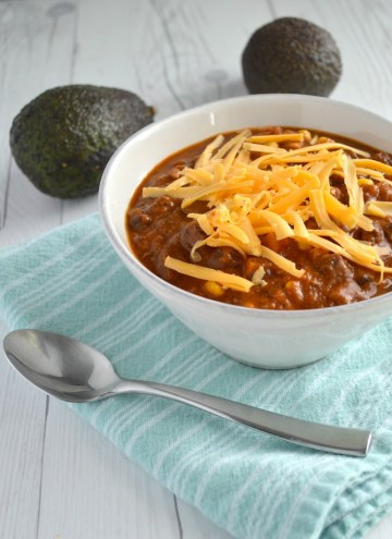 Instant Pot vegetarian chili in white bowl with 2 avocados