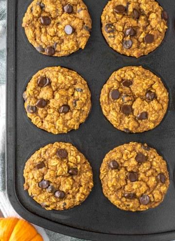 overhead shot of pumpkin oatmeal muffins in muffin tin