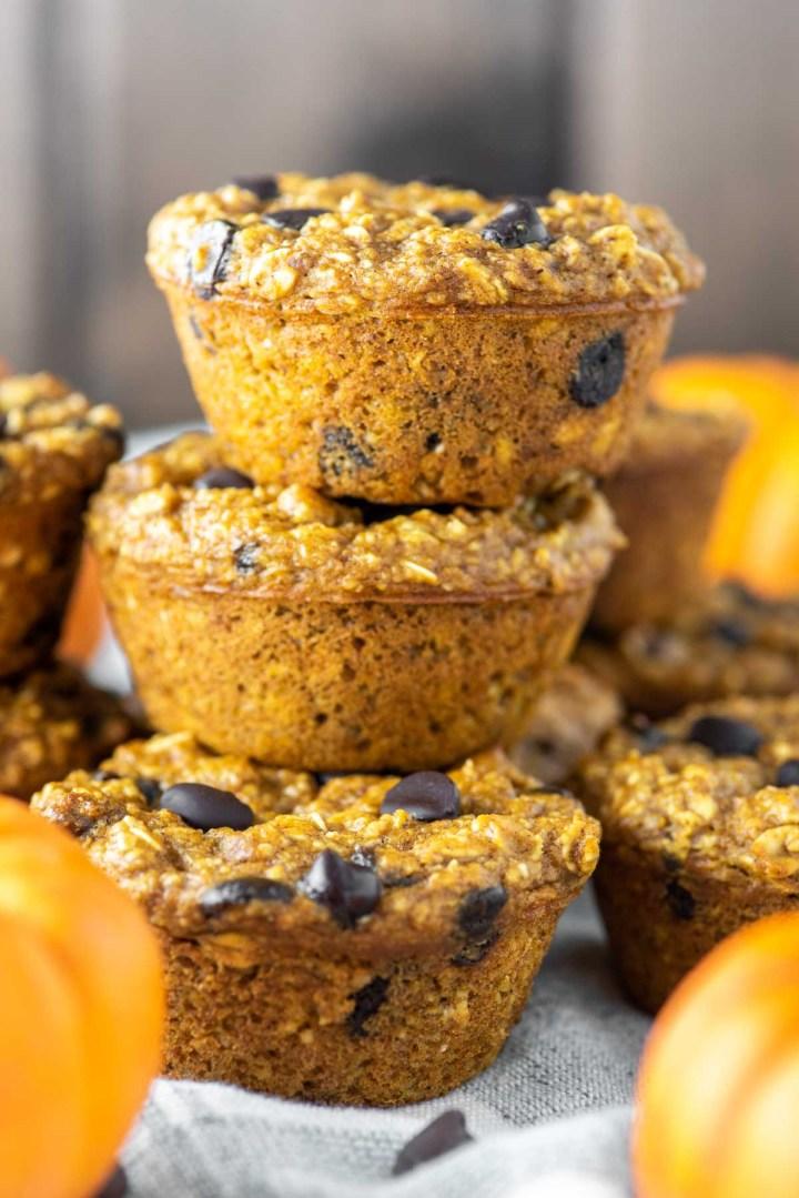 three stacked pumpkin oatmeal muffins