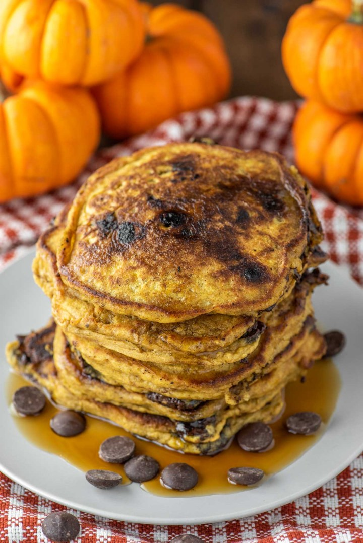 pumpkin chocolate chip pancakes on plate