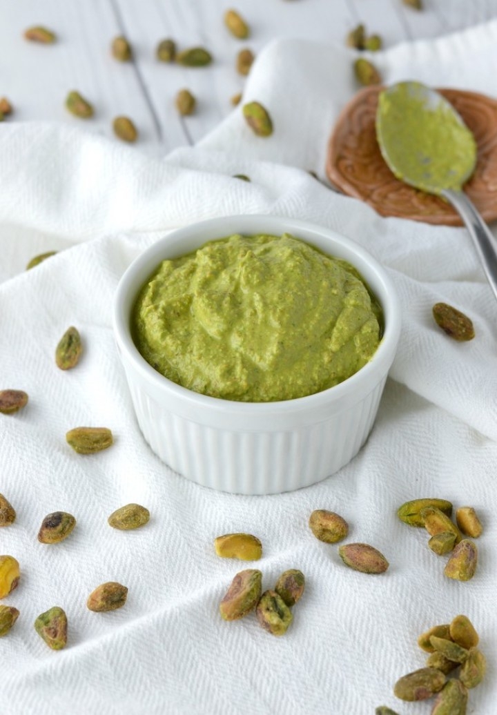 close-up of basil pistachio sauce in white ramekin