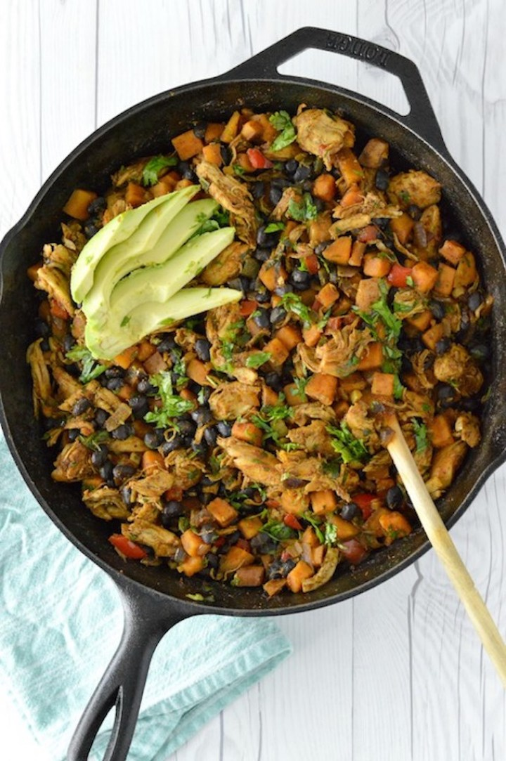 overhead shot of chili lime sweet potato and chicken skillet in iron skillet
