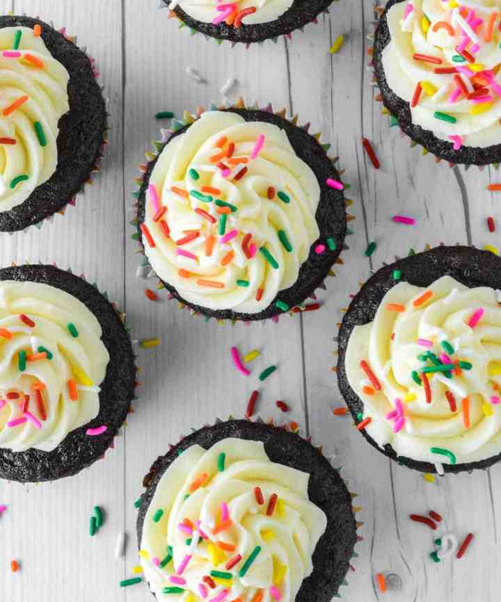 overhead shot of chocolate cupcakes with vanilla frosting