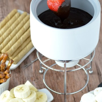 close-up of strawberry dipped in dark chocolate fondue
