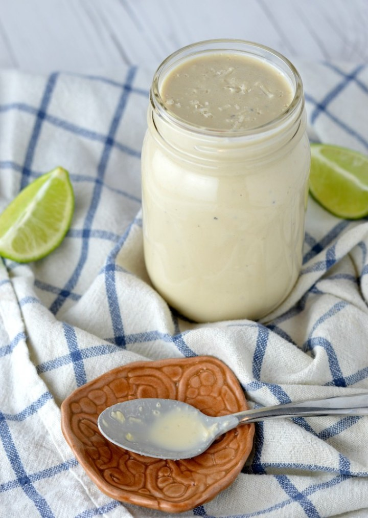 close-up of lime caesar dressing in mason jar