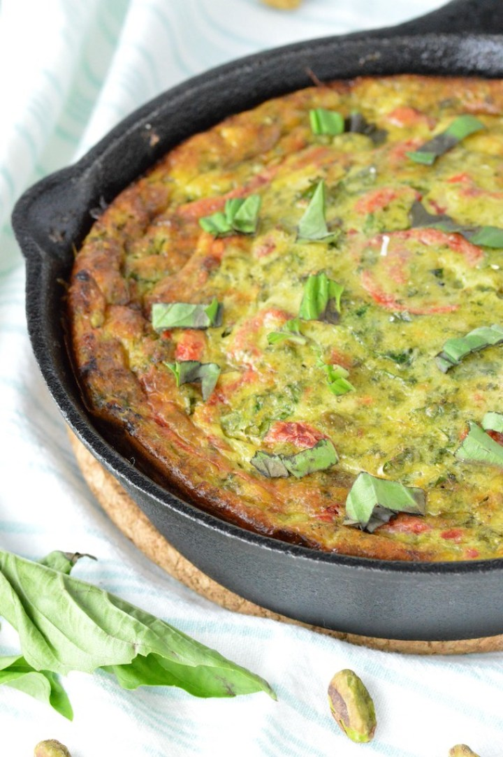 close-up of roasted red pepper frittata in cast iron skillet
