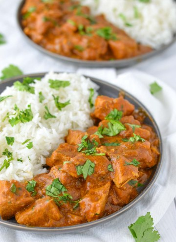 close-up of slow cooker Indian butter chicken in slate plate