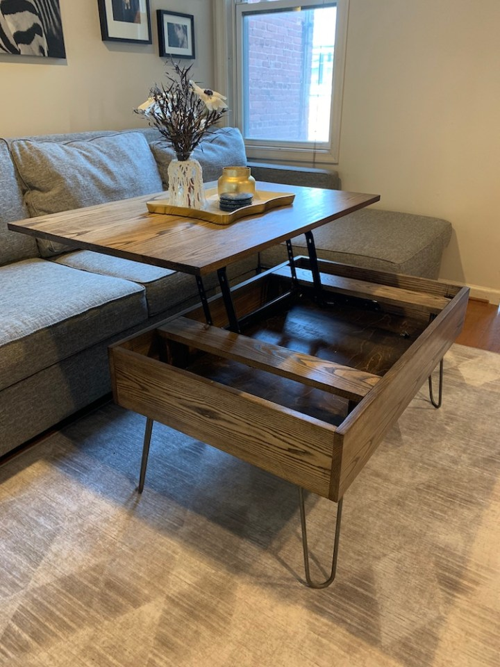 photo of DIY lift top coffee table opening up in living room