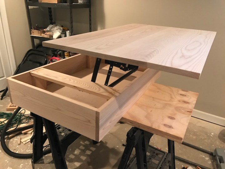 installing lift top mechanism to top of table