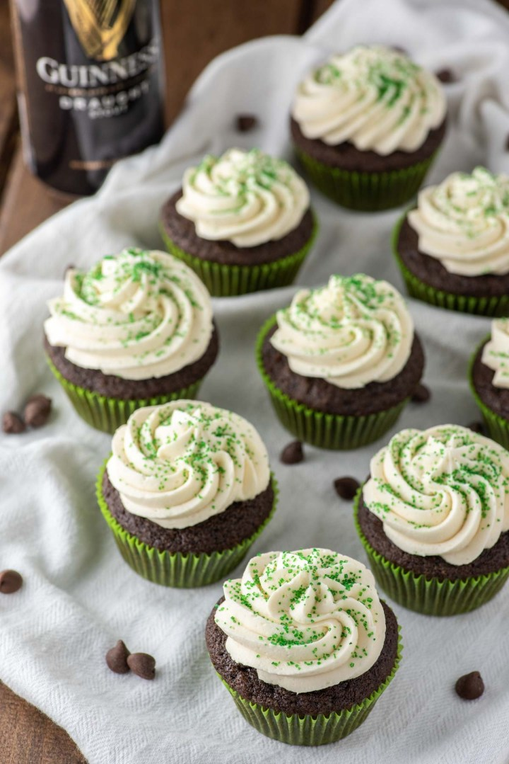 nine Irish Car Bomb cupcakes on white dish towel with Guinness beef in background