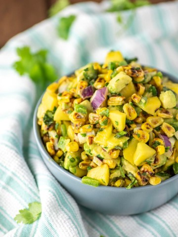 corn mango salsa in blue bowl