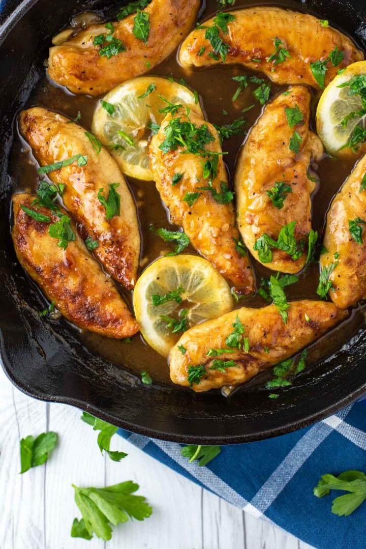 overheat shot of honey lemon chicken in cast iron skillet