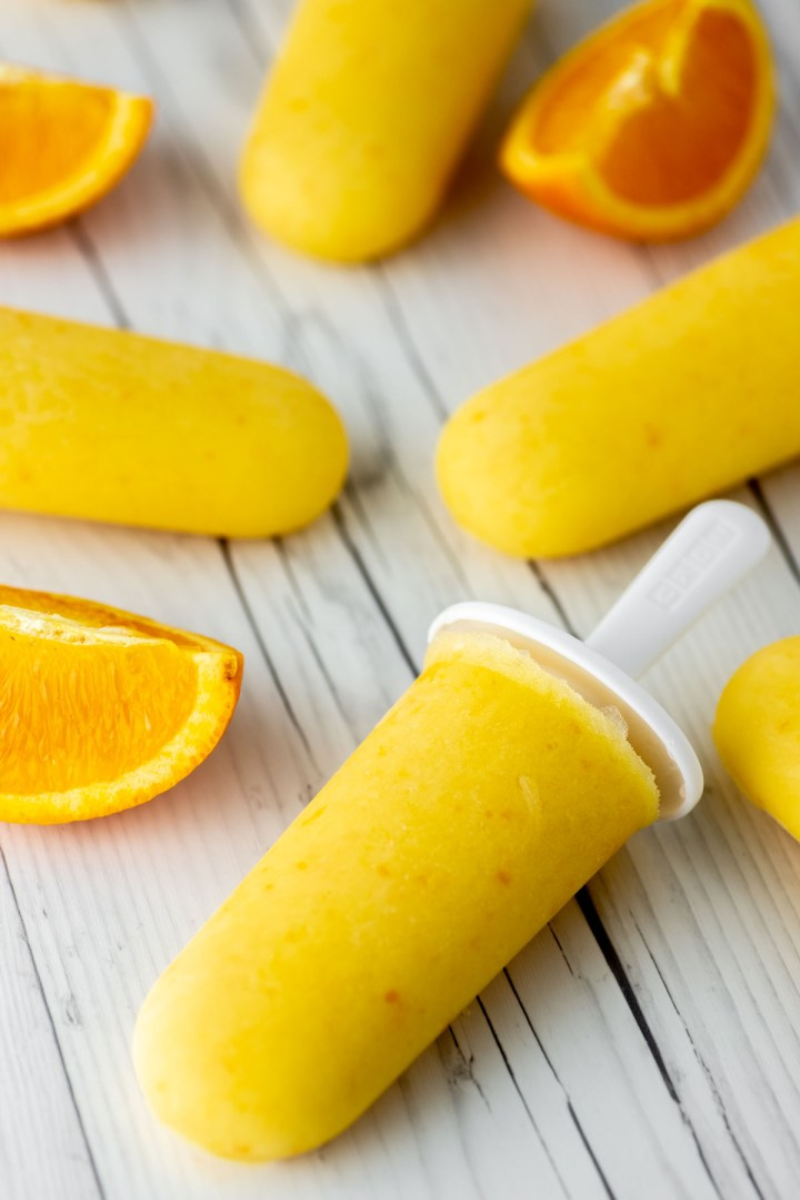 orange creamsicles laying on white wood