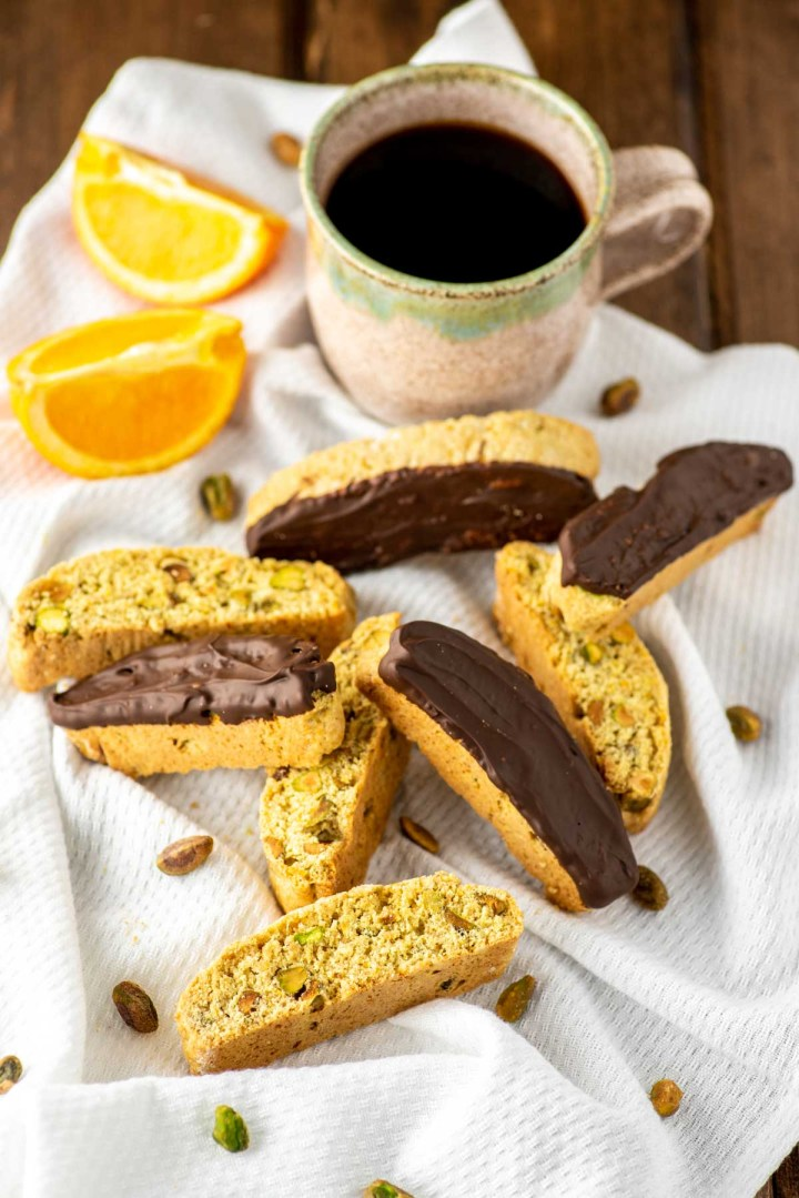 orange pistachio biscotti with cup of coffee