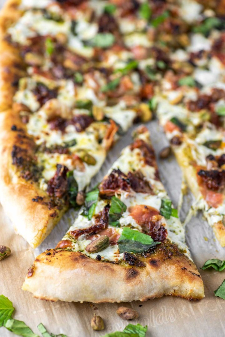 close-up of sun-dried tomato prosciutto pesto pizza